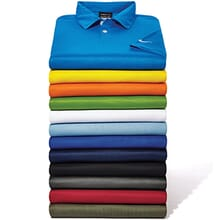 Stack of colorful Nike golf polos