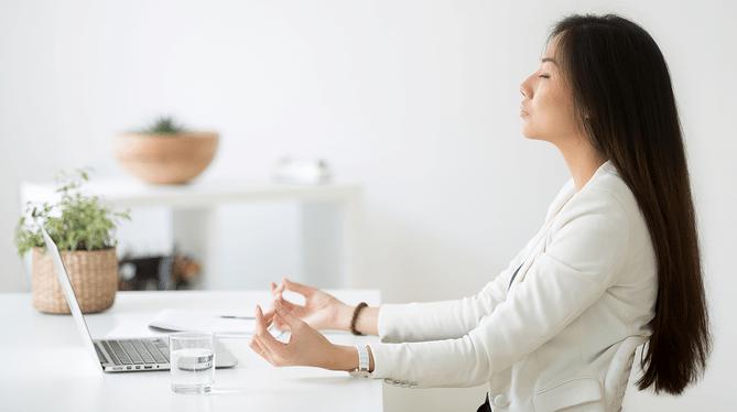 Women meditating at work