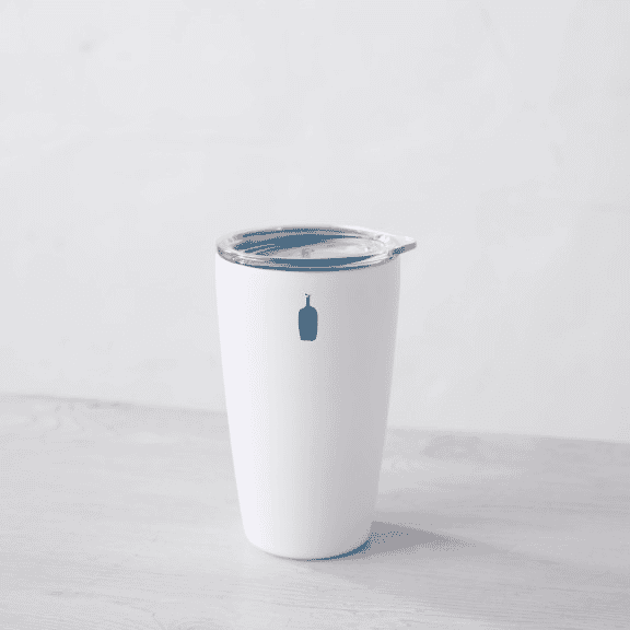 White travel mug with clear lid and bright blue Blue Bottle logo