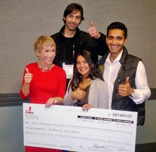 The inventors of the CardNinja accepting a check for $5,000 from Shark Tank investors.