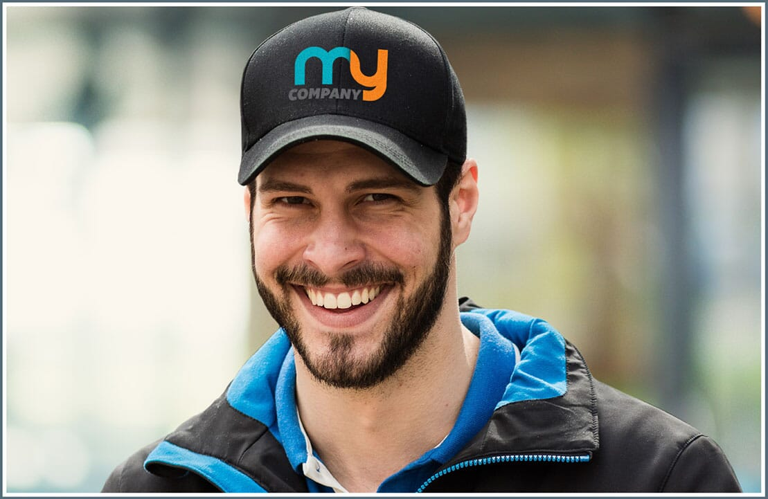 Man wearing hat with corporate logo