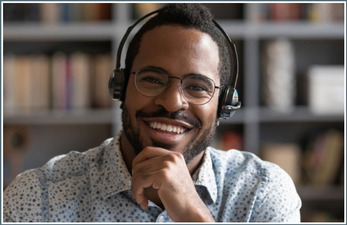 Man wearing headphones and attending online meeting