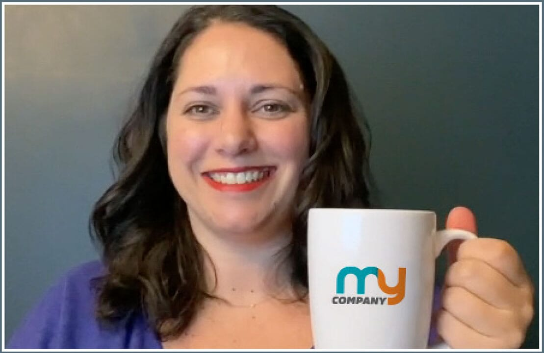 Woman holding up a customized coffee mug with company logo