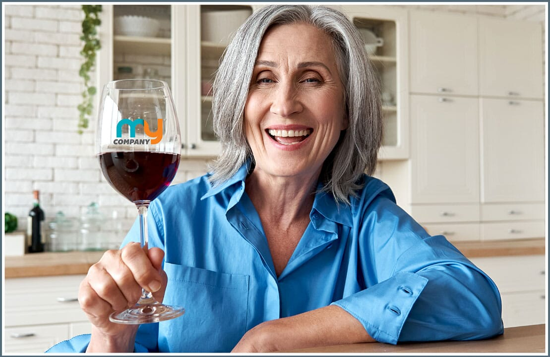 Woman holding up customized wine glass