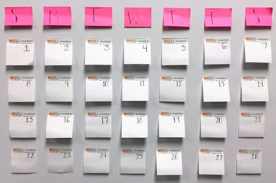 Sticky note calendar on white board