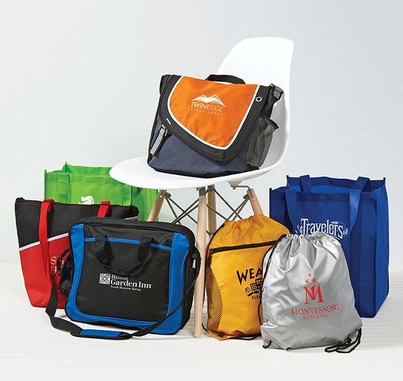 Assortment of custom imprinted bags, totes, and ba ckpacks