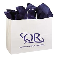 White paper gift bag with deep purple logo