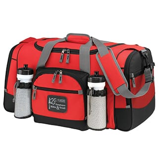 Red duffle bag with black trim, a gray strap and a black and white leather logo