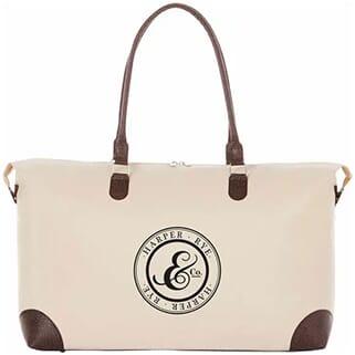 Cream-colored tote bag with dark brown trim and black logo