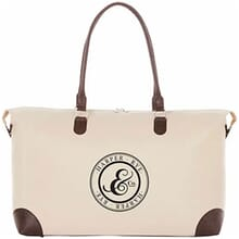 Cream-colored tote bag with dark brown trim and black logo