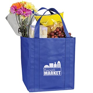 Royal blue grocery tote with food and flowers