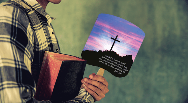 holding bible and religious hand fan