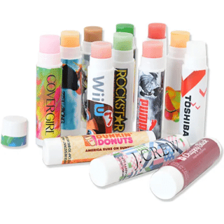 Multiple white tubes of lip balm decorated with colorful logos
