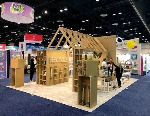 Wooden trade show booth with recycle sign for the company Earth Rated