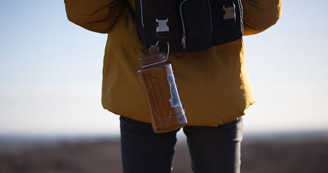 Man Hiking with Orange Water Bottle