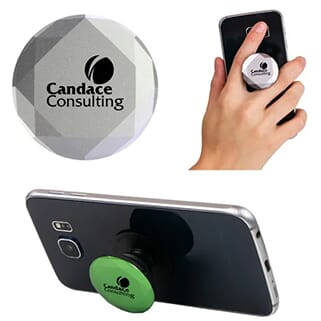 Silver geometric cut PopSockets phone grip with black logo attached to back of black smartphone