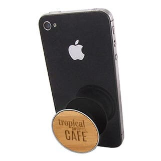 Bamboo PopSockets® phone grip attached to and propping up a black iPhone