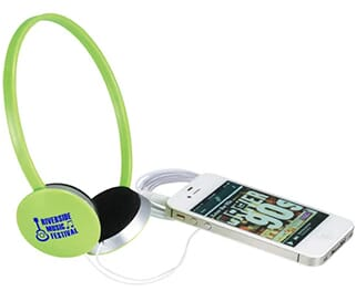 Green headphones with blue logo and white cord running to white iPhone