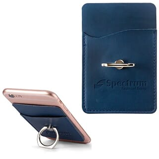 Blue leather phone wallet with attached silver ring stand attached to back of pink iPhone