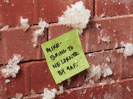 Snowy brick wall labeled with a Post-it Extreme Sticky Note