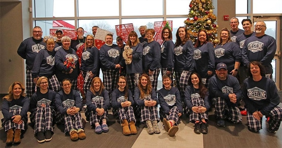 Crestline employees wearing custom pjs for a holiday party