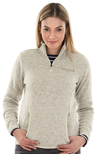 Crestline employee wearing company logo pullover in tan heather
