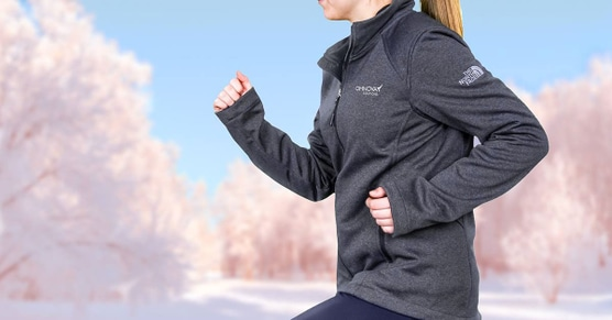 Woman running wearing custom northface athletic top