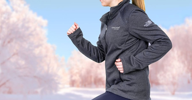 Woman running wearing custom northface athletic top