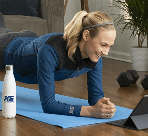 woman exercising from home with fitness giveaways