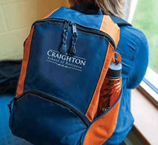 student with customized backpack and water bottle