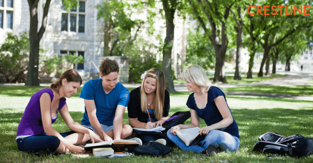 Students studying at college quad
