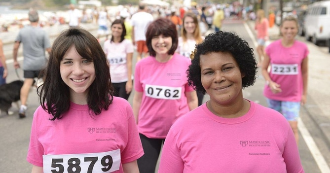 Breast cancer walkers in pink t-shirts