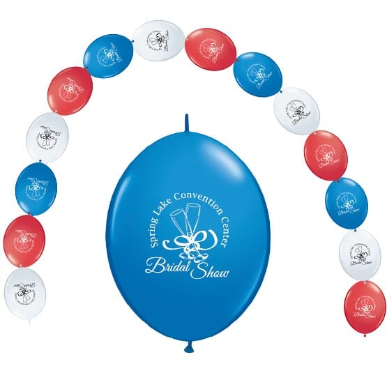 Balloon arch made from red white and blue balloons with logos.
