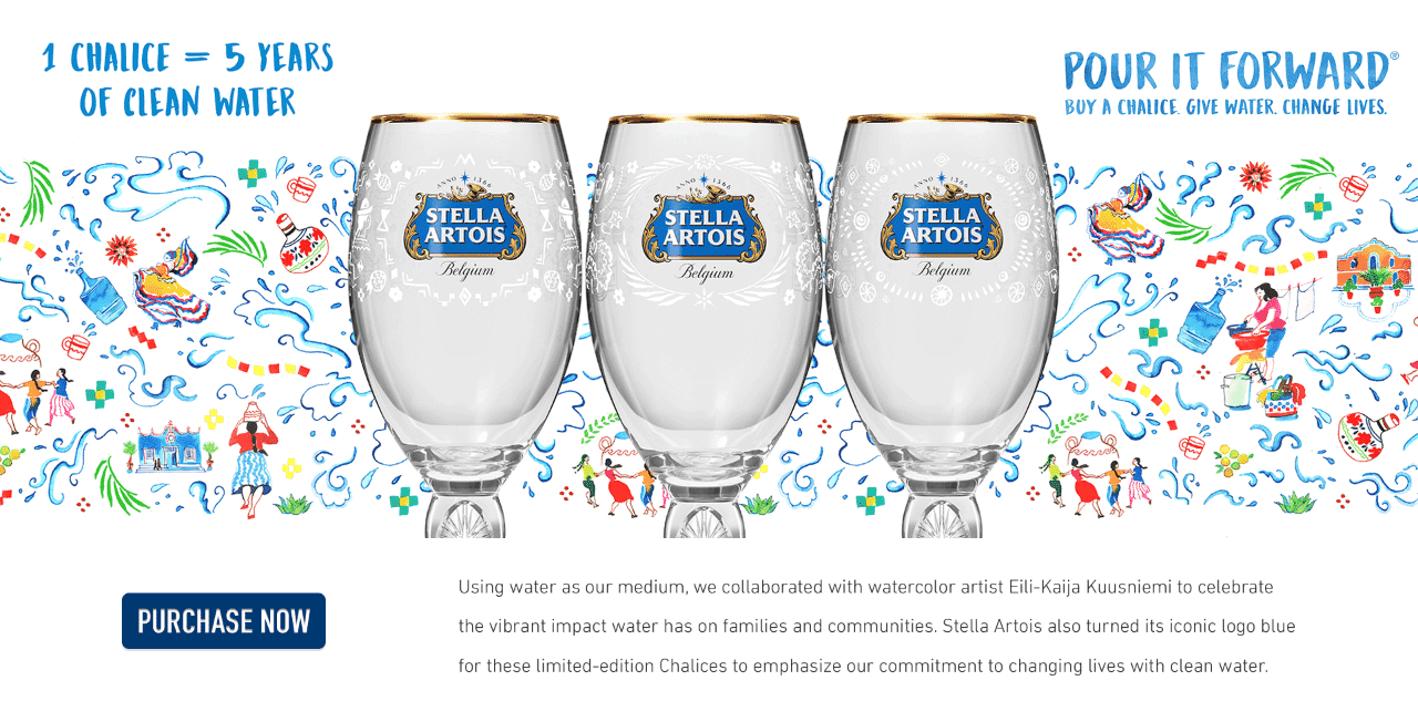 Three glass Stella Artois-branded chalices with gold rims and blue logos against a colorful background