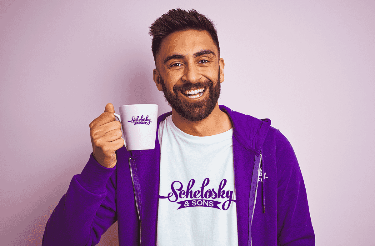 Man happy holding promo mug and wearing promo apparel