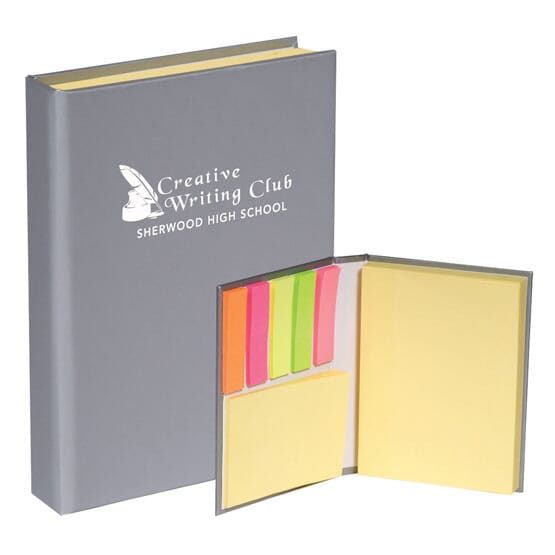 Gray notebook with sticky tags and sticky notes