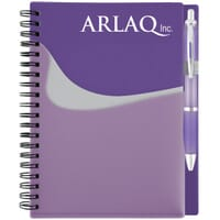 Purple and gray spiral-bound journal with white logo and attached pen