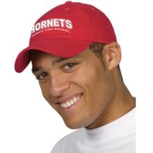 Man wearing custom red baseball cap