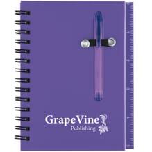Purple spiral bound notebook with sticky notes