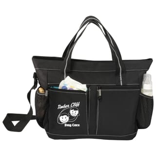Black diaper bag with white logo on front pocket