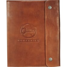 Brown leather notebook with debossed logo and snap closure