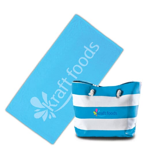 Blue and white striped beach bag with multicolored logo and a matching blue towel