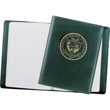 Dark green leather journal with gold foil logo