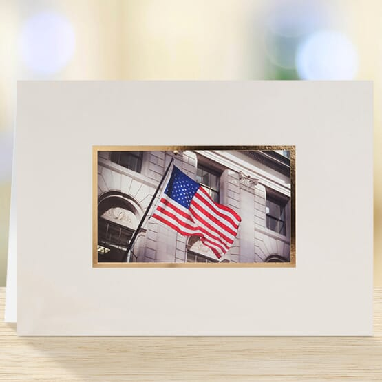 White card with center photo of an American flag.