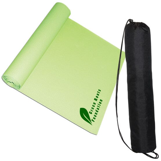 Green yoga mat with logo and black carrying case