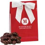 Chocolate covered almonds in gift bag with logo