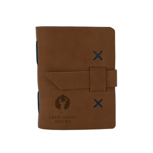 Brown leather journal with contrast stitching and debossed logo