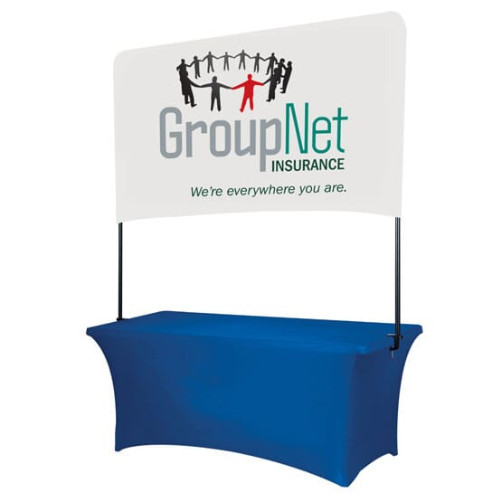 Blue stretchy table covering and attached raised white banner, imprinted with a multicolored logo