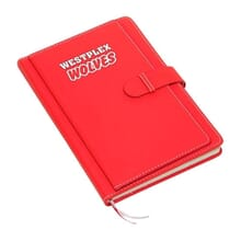 Bright red journal with white logo and strap closure