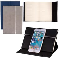Lined notebook with device stand on cover